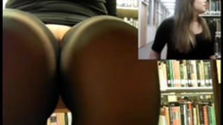 Horny whore masturbating in the library