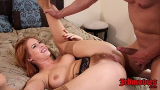 Natural redhead tugs her curly twat