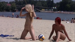 This legal age teenager nudist undresses undressed at a public beach