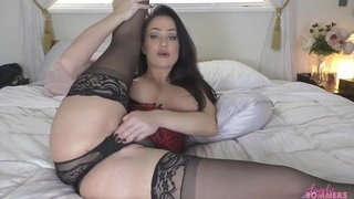 Gorgeous mom with juicy melons masturbates in bed