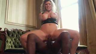 Thick mature with huge melons enjoys riding big black cock